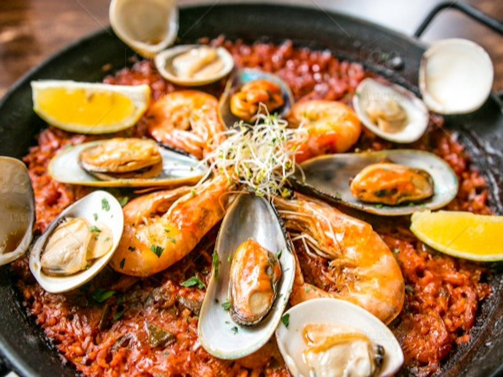 stock_photo_cooking_food_dinner_lunch_rice_seafood_spanish_prawns_paella_7c357499_76b1_40d4_825b_ae8cae73899d_lg