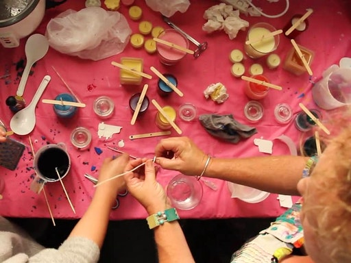 Busy hands at a candle making workshop