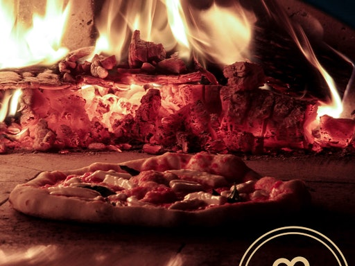 Here's a peek at a pizza baking in the wood flames